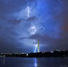 Lightning strikes outside of an approaching thunderstorm, June 25, 2014. (Kevin Ambrose)