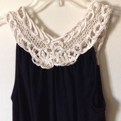 """Crochet trim reversible tank top Really cute tank top with crochet trim on top of a black tank top with gathered elastic waist, you can wear reverse this top to have a higher neckline like the first pic or a lower neckline like the last pic, very stretchy, will fit up to 34"""" bust, length is 26"""" Forever 21 Tops Tank Tops"""