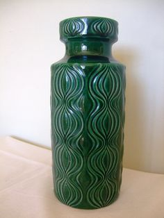 A vintage 1960s-70s West German ceramic vase by Scheurich. This is a beautiful green vase standing at 30cm and decorated with the highly