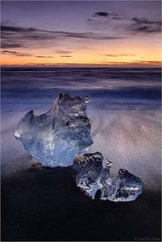 Beached Jewels    Another image from our 12 day winter tour around Iceland together with Örvar from www.flickr.com/....    The prerequisite of having spectacular sky colors at dusk or dawn reflecting on the beach can be difficult to obtain during Icelandic winters. In this case the clear skies were associated with a stationary low pressure system to the northeast of Iceland. The anticlockwise rotation of a cyclone lead...