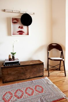 The print is an Inez Van Lamsweerde and Vinoodh Matadin poster from Matthew Marks Gallery; we got it framed at AI Friedman. The rug and coat rack are vintage (the hat hanging is Rag and Bone)