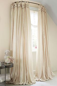 Use a curved shower curtain rod to make a window look bigger ...
