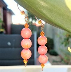 Check out this item in my Etsy shop https://www.etsy.com/au/listing/505531336/gold-plated-ear-wire-orange-crystal