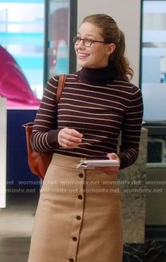 Kara's striped turtleneck sweater and camel button-front skirt on Supergirl.  Outfit Details: https://wornontv.net/65499/ #Supergirl