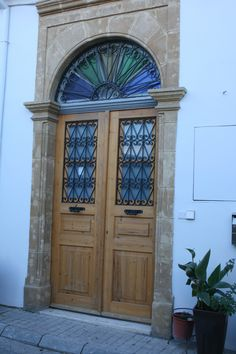 wooden #doors with beautiful window glass detail