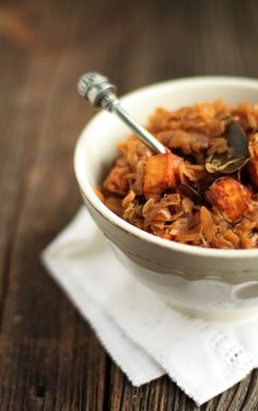 "A warm, stick-to-your-ribs bowl of Bigos (a traditional Polish cabbage ""Hunter's Stew""). Tradition polish cabbage dish- a vegetarian version of it with dry plumbs and deep fry panir cheese cubes."