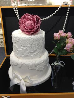 Cute 2 tier wedding cake with lace and pink peony. Wedding cakes London, Hertfordshire, Essex and Kent.