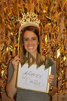 New Year's Eve Party Idea - Photobooth with whiteboard to write a resolution.
