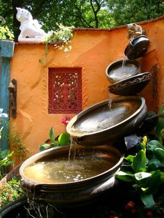 Still trying to find the right water feature for my hill. Antique Urli Bowls