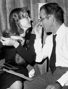 Humphrey Bogart and Lauren Bacall between rehearsals for a 1946 Lux Radio Theater adaptation of To Have and Have Not, in which both actors revisited their original screen roles.
