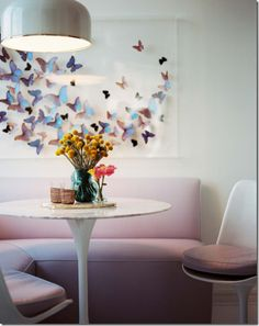 Kitchen Nook by Celerie Kemble. Love the butterflies on the wall.