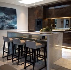 I LOVE the marble transition from the floor to the breakfast bar island. Stunning! - Laura Hammett Interiors