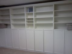Ikea Billy bookcase installed and trimmed out wall-to-wall. Wouldn't put doors on all units but love the idea of closed storage for certain things...china, linens, office stuff, ugly stuff, haha