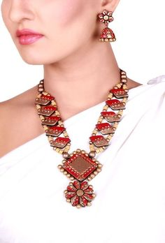 Maroon golden Flower Terracotta necklace set Dimension of necklace: 9.5 inches Dimension of earrings: 2 inches Weight: 84 gms Color: Maroon & golden Closure: Necklace: String, Earring: Metallic lock Material: Terracotta clay Finish: Hand-crafted Inspiration: Elements Of Nature