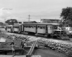 """The only ID on this picture is """"Philippines, 1949"""", probably Manila.  Anyone know about this rail vehicle.  I suspect it was hand made using a large truck engine and cabin mating it to an old tranvia streetcar.   Photograph taken by a """"Life"""" magazine photographer.  Photographer: Jack Birns For personal non-commercial use only Image is copyrighted by © Time Inc"""