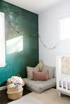 wall color // green wall with pom pom garland. / sfgirlbybay