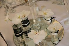 The base of the Candelabras dressed with Phalaenopsis Orchids Phalaenopsis Orchid, Orchids, Elegant Wedding, Wedding Reception, Ceremony Decorations, Table Decorations, Crystal Candelabra, White Wedding Flowers, Centrepieces