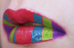 Red,blue,green,and purple striped lips