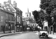 The King's Arms, High Street, Carshalton. Destroyed by a bomb in 1940.  The Coach and Horses is seen in the distance.