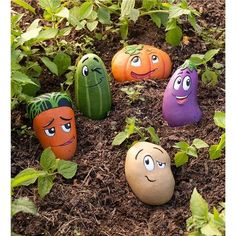 These 5 Piece Garden Stone Set features whimsically cartoony veggie buddies are cast in weather-resistant resin, so they are a delightful addition to your garden and as markers in your vegetable bed. But with their adorable expressions and bright colors, Stone Crafts, Rock Crafts, Crafts With Rocks, Vegetable Bed, Vegetable Gardening, Vegetable Garden Markers, Veggie Gardens, Rock Painting Designs, Stone Art Painting