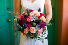 Peachy roses, bright dahlias, blue thistle, and some succulents make for a colorful bridal bouquet | LILLA BELLO Photo by Callaway Gable Studios