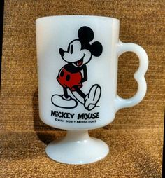 Check out this item in my Etsy shop https://www.etsy.com/listing/217484070/vintage-mickey-mouse-mug-milk-glass