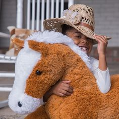 Every cowgirl needs a hat and a trusty steed.