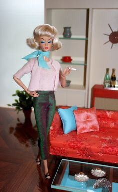 Vintage Barbie at home in her mod living room.  Even Barbie smoked back then, lol