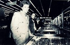 Johnny Rotten (Lydon) and members of The Sex Pistols playing pinball machines.