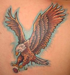 Eagle With Lotus Flower In Claw Tattoo
