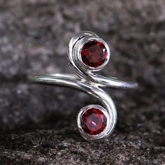 This handmade creation is offered in partnership with NOVICA, in association with National Geographic. Garnets blush with passion's fervor in a cocktail ring from India. Set in sterling silver, the ge