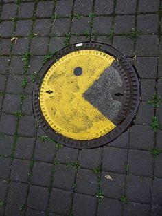 Street Art - Graffiti - Urban culture. it8bit: Pac-Manhole Cover  Spotted inGöttingen, Germany; Mensa-Tower. via:StreetArtNews