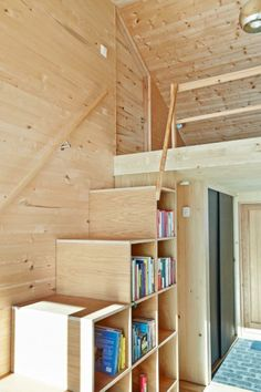 Similar to our home's setup to our loft. Noting the size of  the shelving units for this particular staircase.