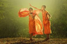 The powerful battle by Jakkree Thampitakkul on 500px,Young buddhist monk getting dressed.,Thailand