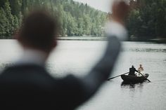 This is from photographer Jonas Peterson (one of my absolute favs)...as far as I could read from the story, the bride is being rowed to shore by her father with the groom on shore waving...what a beautiful idea!