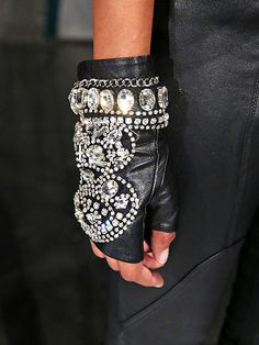 The Fashion Week Edition | BEDAZZLED GLOVES | Fingerless leather gloves evoke image of scary biker gangs. Those biker gangs would be much less intimidating, though, if they were wearing these crystal-encrusted ones, seen at the Fashion Shenzhen presentation.