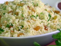 Herbed Couscous with Golden Raisins and Pine Nuts recipe from Jamie Deen via Food Network