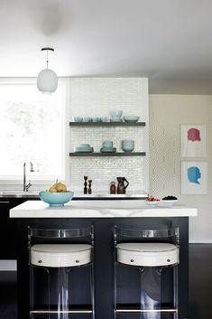 Love this kitchen: dark wood, white countertops, open shelving on Ann Sacks subway tile walls, fantastic 1970's Lucite barstools