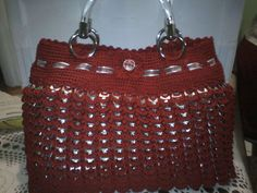 pull tab purse.  No pattern...but, I wish I could find it!  ;(