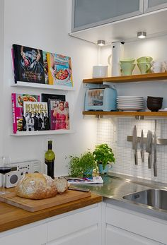 I love so much about this kitchen: cookbook display, magnetic knife rack, open shelving, mini herb garden