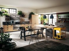 Materials and finishes all have that well-used look: steel is aged, and the types of wood used are all processed to convey a time-worn look and feel. #Diesel #Scavolini #Kitchens
