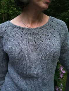 This is my first knitted sweater, as simple as I could make it. Boat neck, no ribbing, 3/4 sleeves, with just enough waist and sleeve shaping to add a bit of elegance. Top-down construction means no seaming!