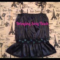 Black satin peplum camisole Pretty camisole with spaghetti straps and sequin trimmed waist. Could fit a size Med or Lg. Tops Camisoles