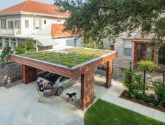 This flat-roof style is perfectly suited for a garden space on top, for added greenery. City Park Carport, New Orleans: modern Garage/shed by StudioWTA Carport Designs, Garage Design, Roof Design, Garage Renovation, Garage Interior, Garages, Carport Garage, Garden Stairs, Fibreglass Roof