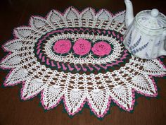 I made this for My Mother-in-law's birthday It is from a Leisure Arts book called Delightful Doilies