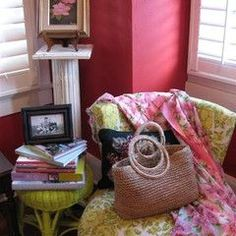 cute painted wicker furniture, pretty feminine fabrics, love the chair. and stack of books