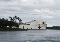 PEARL HARBOR (June 25, 2014) The Military Sealift Command hospital ship USNS Mercy (T-AH 19) passes hospital point as the ship arrives in Hawaii for Rim of the Pacific (RIMPAC) 2014. RIMPAC is a multinational maritime exercise hosted by Commander, U.S. Pacific Fleet designed to foster and sustain international cooperation on the security of the world's oceans. (U.S. Navy photo by Mass Communication Specialist 2nd Class Tim D. Godbee/Released)