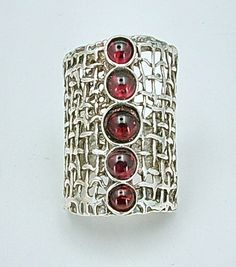 Sterling Silver and Garnet Ring by Hadar on Etsy.