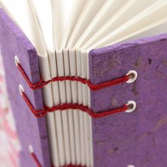 Closeup of red coptic stitching on purple paper - handmade book by Ruth Bleakley | Flickr - Photo Sharing!