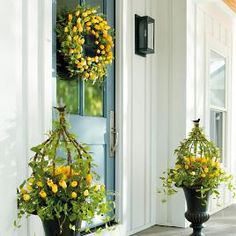 Brighten your yard with outdoor artificial flowers and faux greenery from Grandin Road. Shop colorful arrangements for a maintenance-free garden. Farmhouse Front Porches, Rustic Farmhouse, Boxwood Garden, Garden Trellis, Spring Door, Spring Summer, Yellow Tulips, Grandin Road, Mellow Yellow